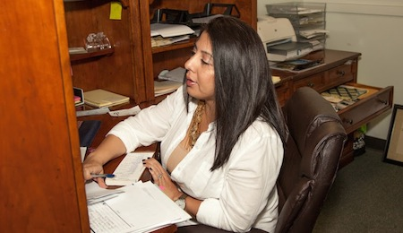 administrator working at her desk