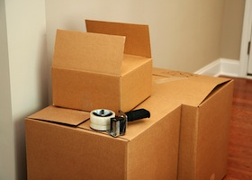 moving boxes stacked in a home with packing materials