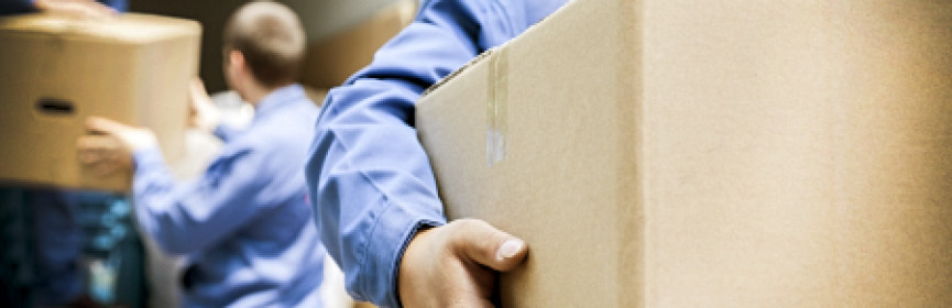 movers moving boxes with care